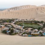 Learning How to Sandboard in Huacachina, Peru