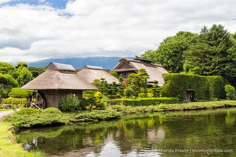 Thatched roof farmhouses and pond at Oshino Hakkai Village