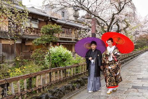 Japan bucket list- Wear a kimono (young couple walking down a street in Kyoto wearing traditional kimonos)