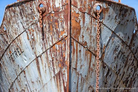 Rusty hull of the Petrel ship