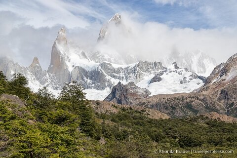 Mount Fitz Roy partially covered by clouds.
