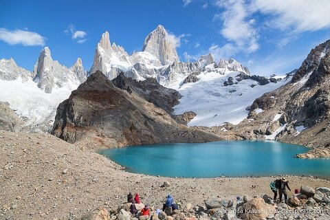 Hikers sitting on the rocks near Mt. Fitz Roy and Laguna de los Tres.