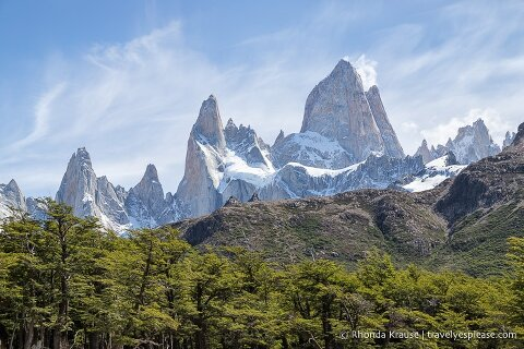 Mt. Fitz Roy overlooking a hill and forest.