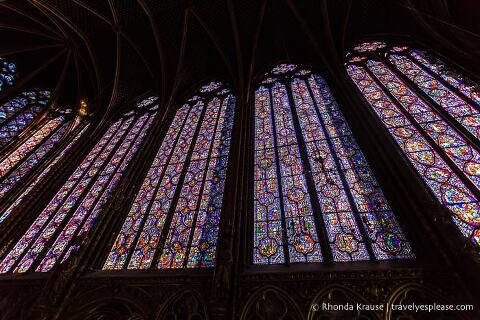 Wall of stained glass inside Sainte-Chapelle.
