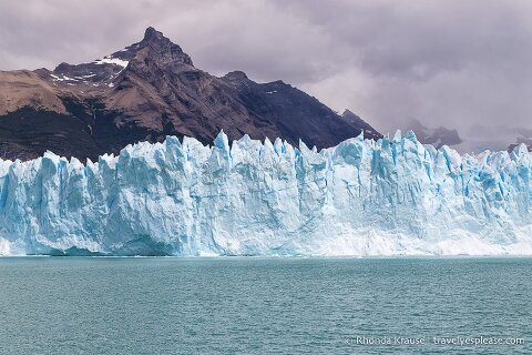 Glacier backed by a mountain, as seen from the boat cruise on Lago Argentino.