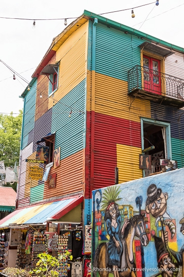 Colourful building, mural and souvenir shop in the Caminito.